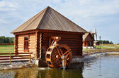 Working water mill in russian village — Stock Photo