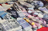 Woolen mittens at russian market — Stock Photo