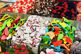 Many colorful candies on market stand — Stock Photo
