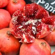 Stock Photo: Pomegranates on market stand