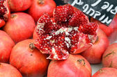 Pomegranates on market stand — Stock Photo