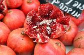 Pomegranates on market stand — Stock Photo