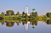 Cathedral with bell tower and his reflection in water — Stock Photo