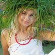 Beautiful womwearing crown of grass and Slavic costume. — Stock Photo #13219265