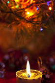 Christmas background. Focus on candle. — Stockfoto