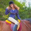 Stock Photo: Young girl riding horse.