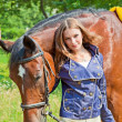 Stock Photo: Portrait of young girl with horse.