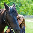 Portrait of a young girl with a horse. — Stock Photo #24639301