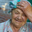 Elderly laughing womin work clothes. Break after work — Stock Photo #26408111