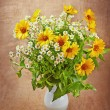 The bouquet of autumn flowers on the old canvas background, rust — Stock Photo