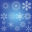 Stock Vector: Snowflakes, Christmas design elements on blue background