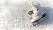 Women white skates. Abstract background on a winter sports theme — Foto Stock