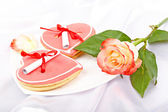 Heart shaped cookies with notes and rose. Pleasant surprise for  — Stock Photo