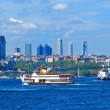 The ferry sails along the New houses on the banks of the Bosphorus — Stock Photo