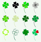Set of 12 lucky clovers — Stock Vector