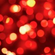 Defocused red holiday lights — Stock Photo #2552470