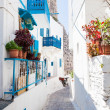 Narrow street in greek city — Stock Photo