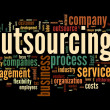 Outsourcing concept in word tag cloud on black background — Stock Photo #13421462
