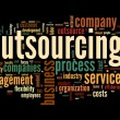Stock Photo: Outsourcing concept in word tag cloud on black background