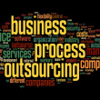 Stock Photo: Business process outsourcing concept in word tag cloud on black background