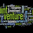 Joint venture concept in tag cloud on black background — Stok fotoğraf