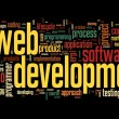 Web development concept in word tag cloud on black background — Stock Photo