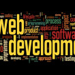 Web development concept in word tag cloud on black background — Stock Photo #13721758