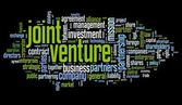 Joint venture concept in tag cloud on black background — 图库照片