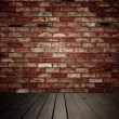 Brick wall and wooden planks - Stock Photo