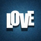 Love concept - paper letters on textile — Stock Photo