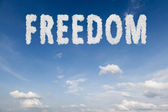 Freedom concept text in clouds — Stock Photo
