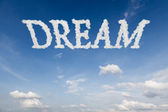 Dream concept text in clouds — Stock Photo