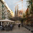 Sagrada Familia at the end of Avinguda Gaudi. Barcelona, Spain. - Stock Photo