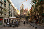 Sagrada Familia at the end of Avinguda Gaudi. Barcelona, Spain. — Stock Photo