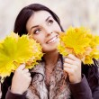 Woman with leaves — Stock Photo #12542417