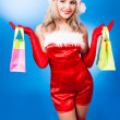 Woman dressed as Santa — Stock Photo #13160307