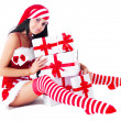 Woman dressed as Santa — Stock Photo #13160320