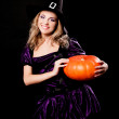 Witch with a pumpkin — Stock Photo #13160388