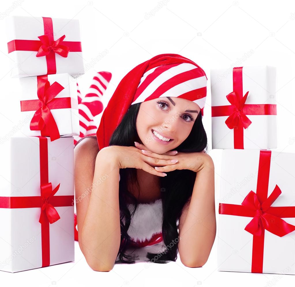 Beautiful young brunette woman dressed as Santa with presents, isolated against white background  Stock Photo #13160333