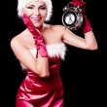 Woman dressed as Santa — Stock Photo #13865405