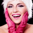 Woman dressed as Santa - Stock Photo