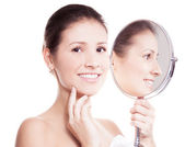 Woman with mirror — Stock Photo