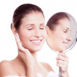 Woman with mirror — Stock Photo #16358785