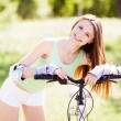 Stock Photo: Woman riding a bicycle
