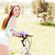 Woman riding a bicycle — Stock Photo #16494215