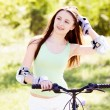 Woman riding a bicycle — Stock Photo #16494321