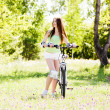 Woman riding a bicycle — Stock Photo