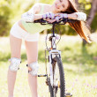 Woman riding a bicycle — Stock Photo #16502147
