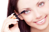 Woman applying mascara — Stock Photo
