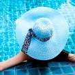 Woman in the swimming pool — Stock Photo